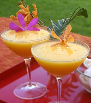 Mango Margaritas yummm!! (1 large, ripe mango, 1 cup tequila, 1/2 cup triple sec, 1/3 cup lime syrup, 1 cup ice).