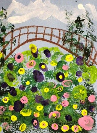Kindergarten students learned about Claude Monet's art and the beautiful gardens he created around his home in France. Students used oil pastel to draw the bridge across Monet's pond and then used sponges to add the greenery. They used their fingers to add the colorful flowers on top of the lily pads.