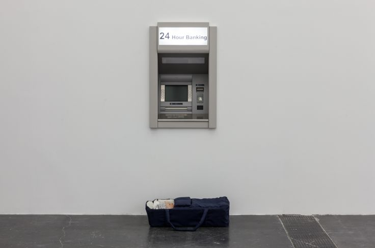 Elmgreen & Dragset, Modern Moses, 2006, carrycot, bedding, wax figure, baby clothes, stainless steel cash machine, 71 x 37 x 16 cm (baby carrycot); 94 x 76 cm (cash machine). Photo by Eric Gregory Powell. Courtesy Galerie Perrotin (at UCCA Ullens Center for Contemporary Art)