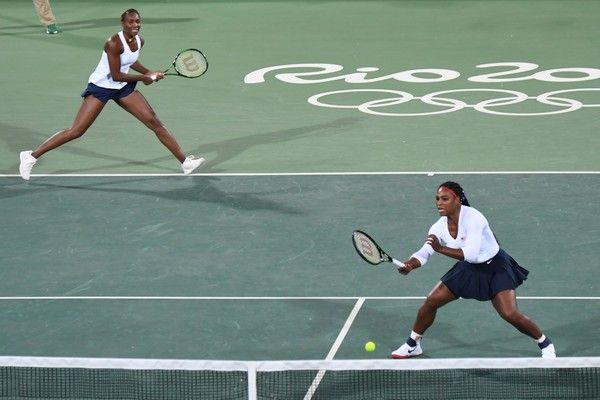 Venus Williams Serena Williams Photos Photos - USA's Serena Williams (R) and USA's Venus Williams return the ball to Czech Republic's Lucie Safarova and Czech Republic's Barbora Strycova during their women's first round doubles tennis match at the Olympic Tennis Centre of the Rio 2016 Olympic Games in Rio de Janeiro on August 7, 2016. / AFP / Martin BERNETTI - Tennis - Olympics: Day 2