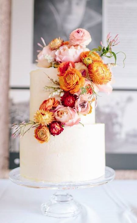 Chic orange and pink flower covered white wedding cake; Featured Photographer: White Tulip Photography, Featured Cake: The Cake and I