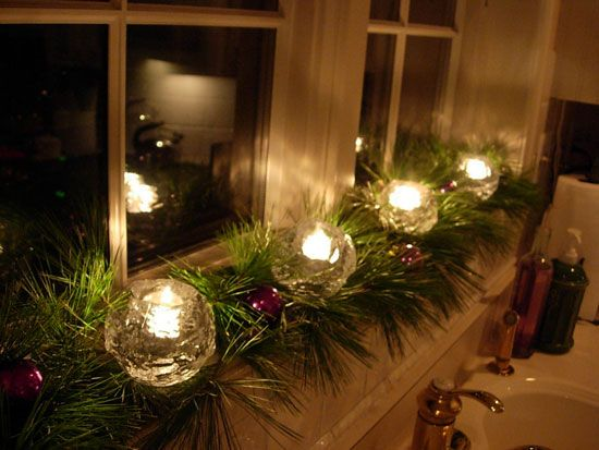 Beautiful window sill with tree cuttings and candles