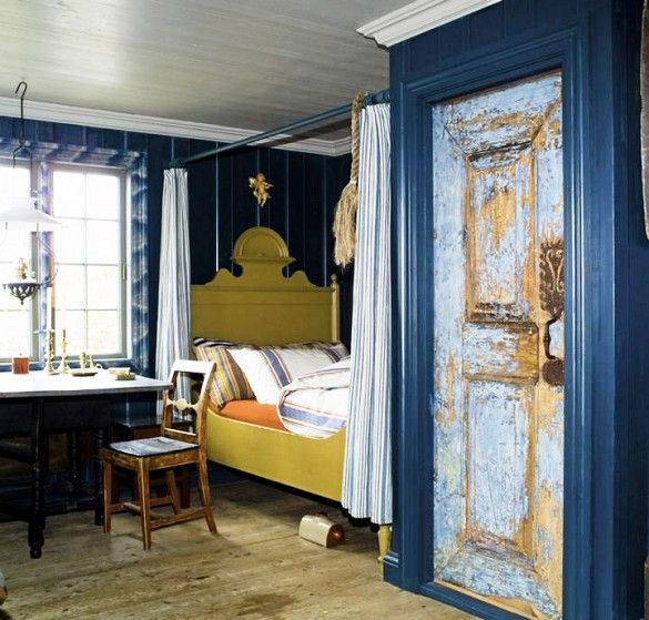 Love the chartreuse bed against the inky blue walls!