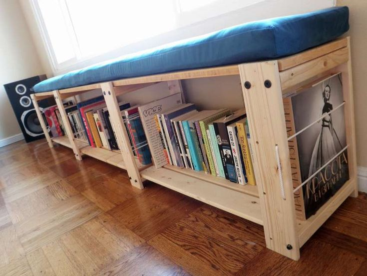 the bench is a Shelf for books with a pillow