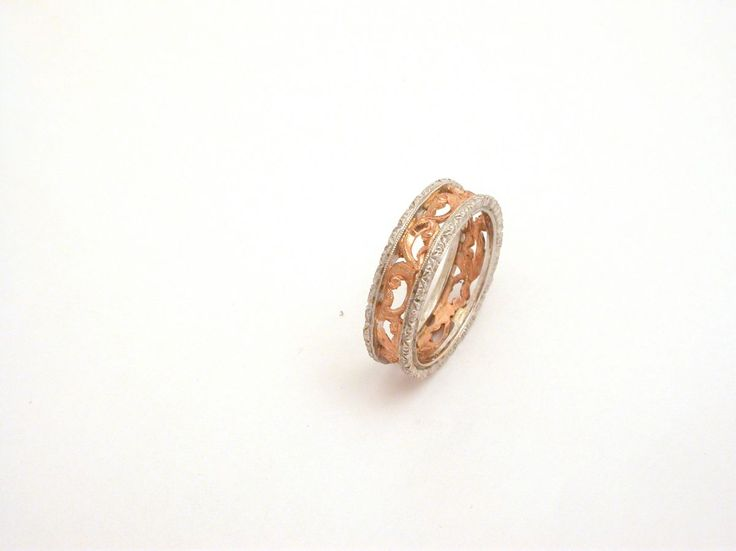 Ring - Ornament - Eternity. 18 carat gold (kt), pink and white gold 5.30 grams (gr). Wide: 0.25 inches (Usa)  6.00 mm (Italy). Size: 8 inches (Usa)   17 mm (Italy). Codex: EPT.ss.