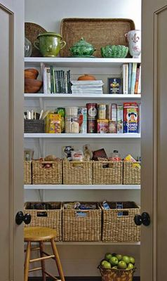 wicker baskets used as pretty pantry containers kitchen pantry organizing ideas