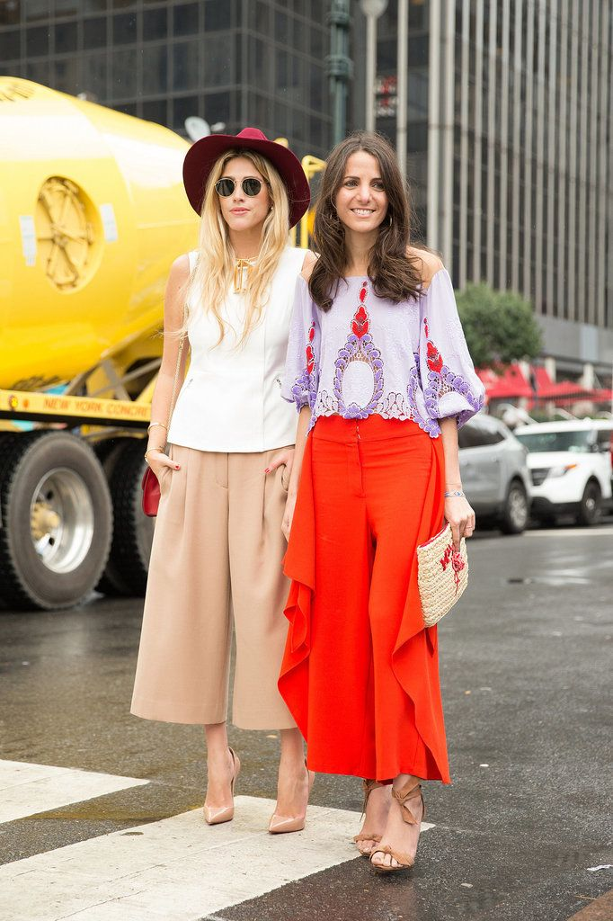 Tailored pants look chic with feminine tops – it's the best of both worlds.