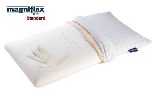 Magniflex Standard -  Geogreen Standard  With its simple yet sensible shape, its Airyform process applied in the core area makes this pillow even more anatomically shaped and breathable. Its tiny holes at the centre of the pillow ensure a constant air circulation with every movement. A pleasant refreshing feeling is gained when the skin touches the fabric.
