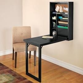 It looks like a simple, non-intrusive wall cabinet, but this folds down into a desk. It would make a great space-saving workspace for my laptop, or my son's homework, and then it would fold neatly away when I'm done browsing Pinterest — er, working.