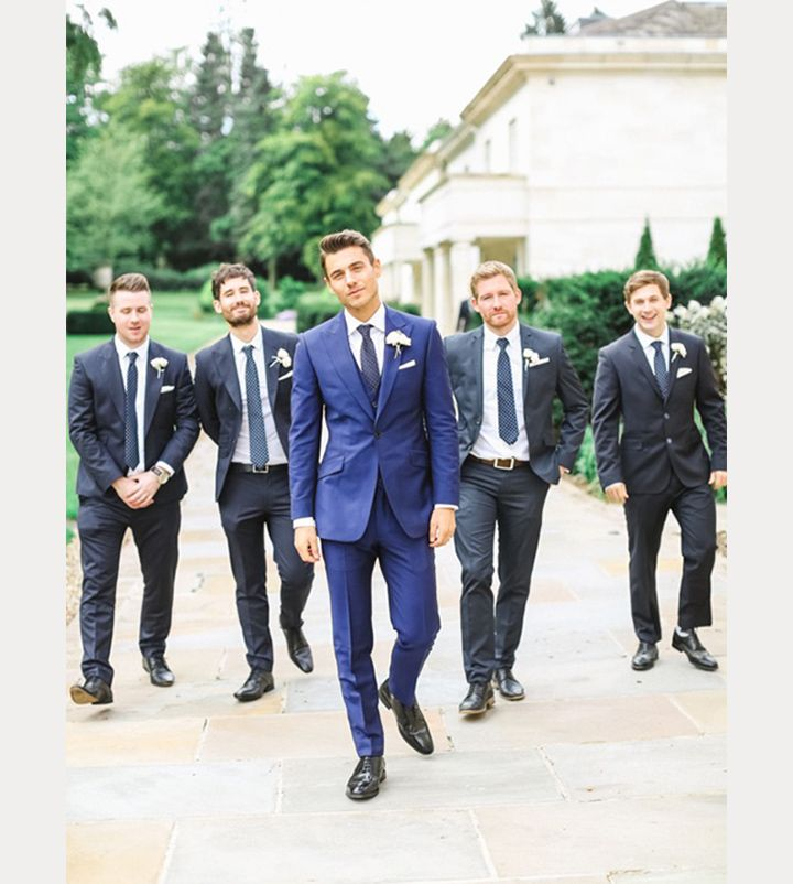 Love this groom's bright blue suit and vest which pops against the groomsmen all in navy ~ we ❤ this! moncheribridals.com