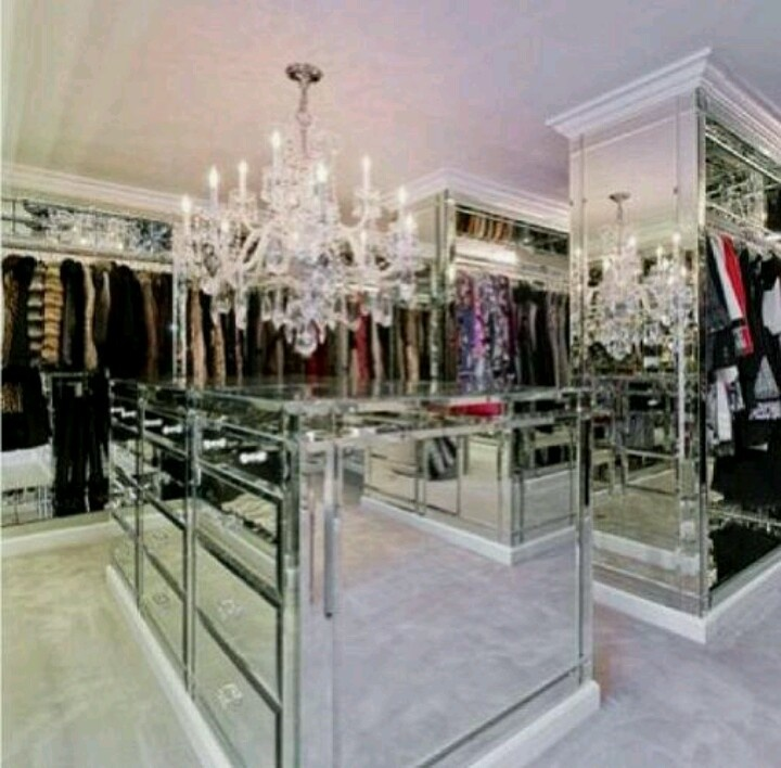Huge Walk In Closet Room Fancy Chandelier Mirrors On Every Wall Surface Aisles Rows Of Floor To Ceiling Shelves Cubbies Multi Level Hanging Rods