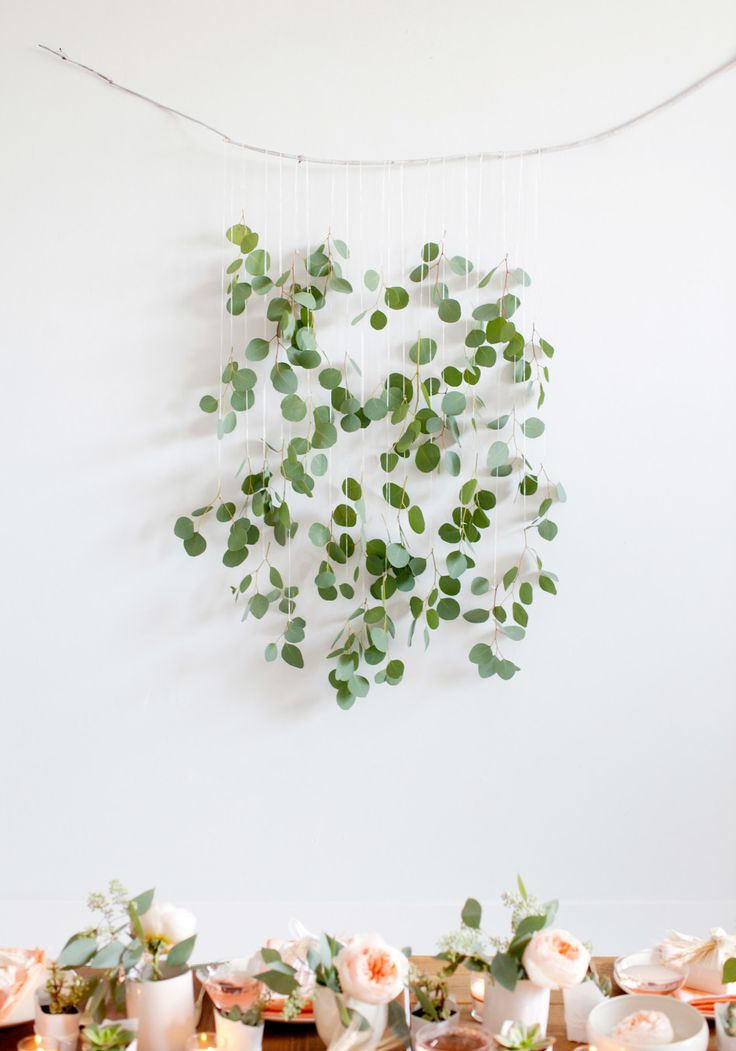 6 Holiday Decorations to Hang on Your Wall (That Aren't Wreaths) || This DIY eucalyptus and branch wall hanging is perfect for the holidays, a wedding, or any party. In fact, you can make it the day of. Here's how.