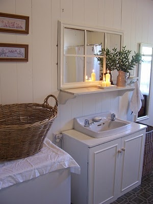 Like the framed mirror on shelf in this mud/laundry room.  I have a window that came out of an old house that still has the price written on it in pencil (less than five dol) that would look great here if the panes were replaced w/mirrors.  It already looks shabby chic from natural aging so I wouldn't have to do anything but replace the panes. hummmm