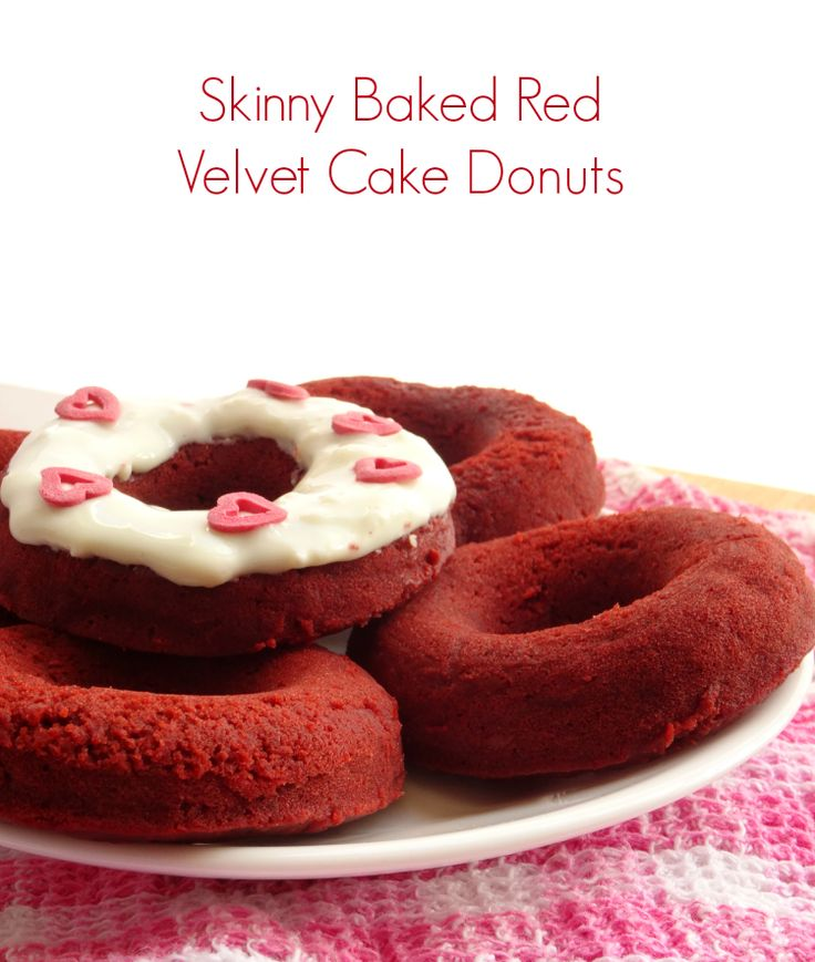 Healthy red velvet donuts that are baked - not fried - and contain hardly any sugar or oil! The perfect healthy Valentine's Day dessert. Get the #recipe here: http://pinkrecipebox.com/skinny-red-velvet-baked-cake-donuts/