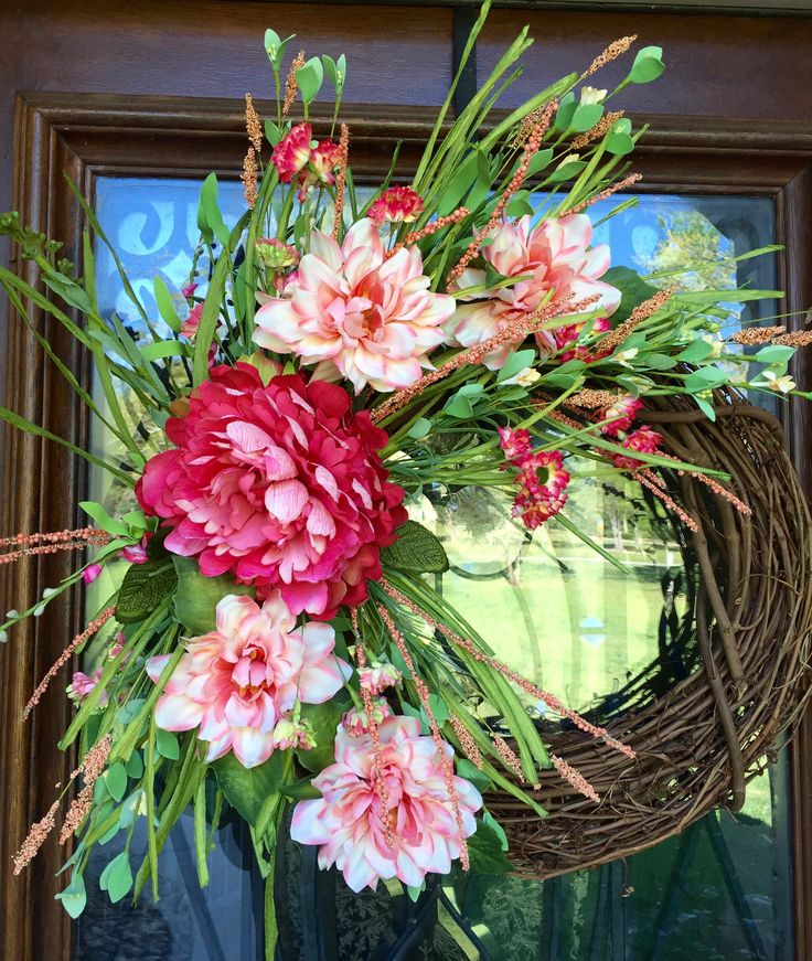 Gorgeous spring/summer grapevine wreath with pink/coral florals