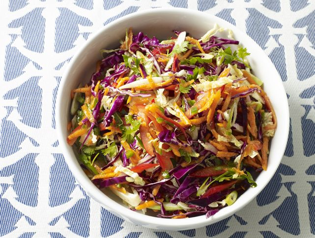 """Firecracker Coleslaw Recipe: With its """"explosive"""" flavor, this coleslaw if far from the mayo-laden boring version you see at summer BBQs! Also, with its vibrant colors, it will surely brighten up the buffet table!"""