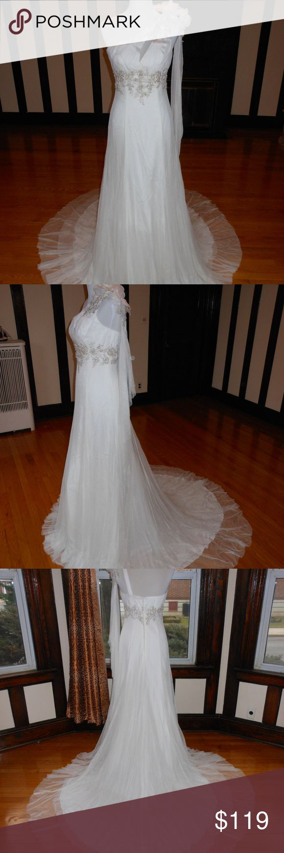 """LILLY Bridal Wedding Dress S02 This is an Authentic LILLY Bridal Wedding Dress Gown. It has a gorgeous fit and flare style with a fabulous chapel train. It comes with a match shawl This dress is brand new in great condition with the original label and tags. It was never worn.  Size: 8 Bust: 35"""" Waist: 28"""" Hips: 38"""" Size: 12 Bust: 38"""" Waist: 30"""" Hips: 38"""" Size: 14 Bust: 39"""" Waist: 31"""" Hips: 40"""" Size: 16 Bust: 40"""" Waist: 32"""" Hips: 42""""  Color: Ivory/Silver LILLY Dresses Wedding"""