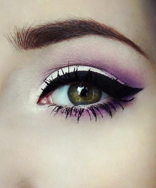 White on the lid, dark purple in the crease, and dark purple to line, blend out purple, put more white on lid. Line in cat eye, and if desired line a little on the bottom. Mascara. (Appears to be what is done here, I'm guessing..)