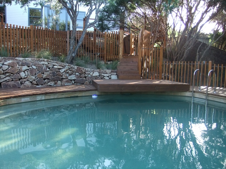 Dry Stone wall and decking by the pool designed and constructed by the team at Abben Art Garden Design