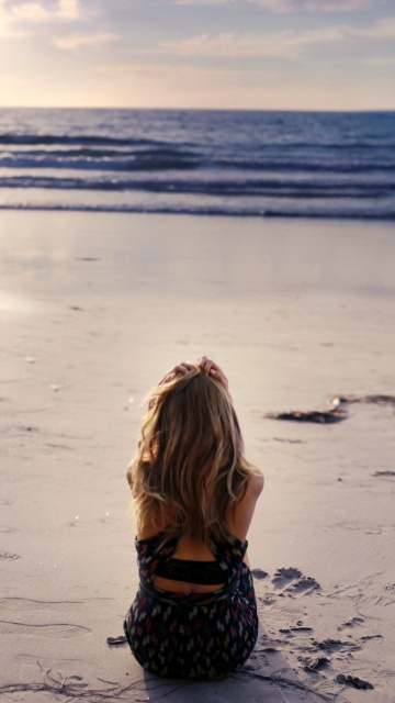 Lonely Girl On Beautiful Beach