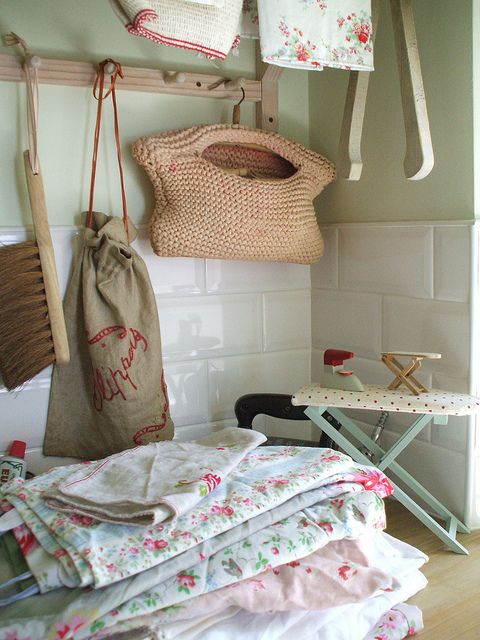 feed sack fabrics and old linens in a basket would look good in the laundry room