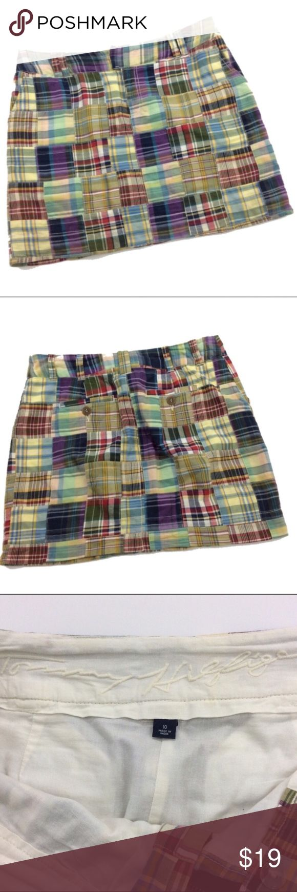 Tommy Hilfiger madras plaid skirt  size 10 Tommy Hilfiger madras plaid skirt, great for summer size 10. Skirt has a four-inch front  zipper with hook closure, fully lined, belt loops, 2/front slash pockets and two back pockets with buttons. Made 100% cotton. Measurements taken from the back with garment laying flat, waist is 34 inches length is 18 inches, all measurements are approximate. Spring break, summer Tommy Hilfiger Skirts