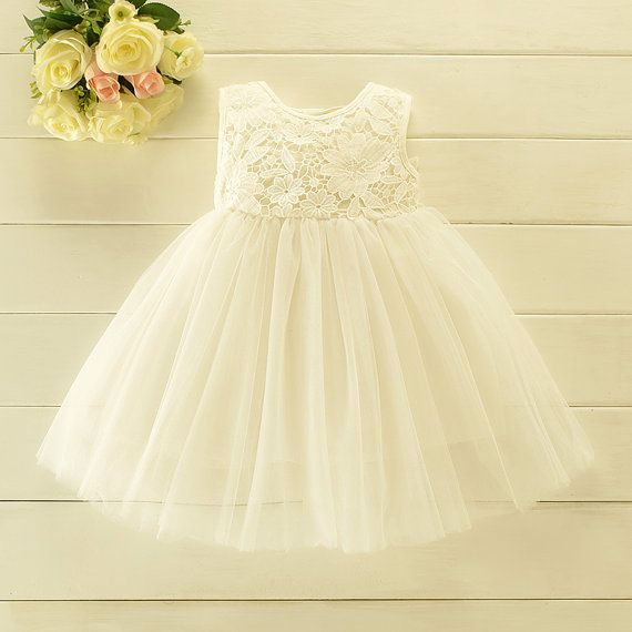 This gorgeous dress is great as a flower girl wedding dress, birthday dress, christening, baptism, photo prop or for any special occasion. The