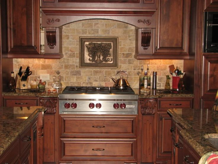 kitchen floor tiles that match cherry wood cabinets cream stone tile kitchen