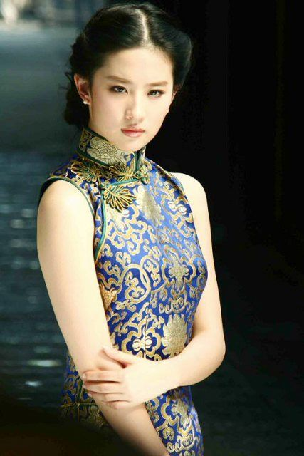 The Qipao or Cheongsam is an elegant and classic garment for Chinese women. With roots in 17th century China, the Qipao has a high collar and a tightly fitting cut, with slits at either side of the skirt. It can be high-necked or collarless, long or short, some with full, medium, short or even no sleeves at all - to suit different occasions, weather and individual tastes.