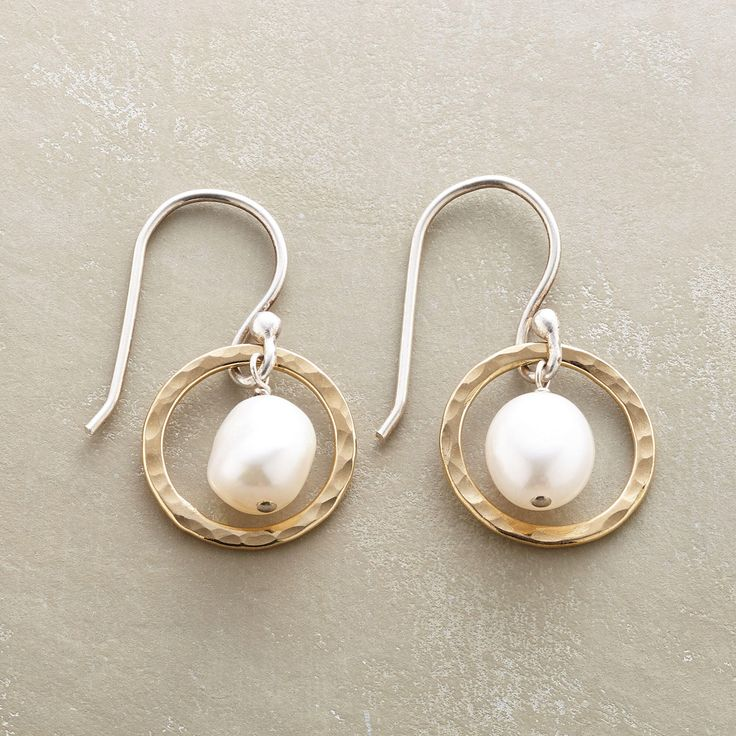 "PEARLS IN HOOPS EARRINGS -- Sterling silver rings coated with 14kt gold orbit around cultured pearls. Sterling silver French wires. Exclusive. Handmade in USA. 1""L."