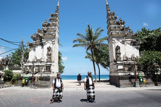 On patrol: Several pecalang, or customary guards, patrol one of the gates to Kuta Beach on Monday, ensuring that residents and tourists alik...