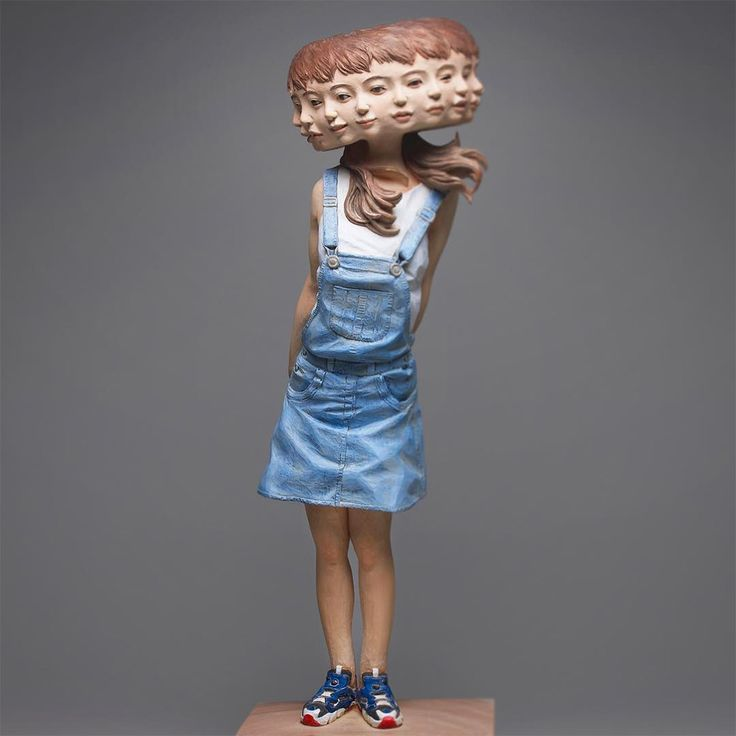 Japanese sculptor Yoshitoshi Kanemaki(previously) produces figurative sculptures with varying abnormalities and glitches, doubling the eyes on some works, while multiplying the heads on others to convey an impressive array of human emotion. Each piece, with sizes ranging from life-size to miniature
