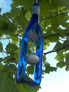 Recycled Wine Bottle Wind Chime. They sell lots of these at craft shows. All types