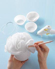 How to make Hanging Bubbly Ball Decorations with a pencil, hot glue gun, Styrofoam ball, and cupcake holders.