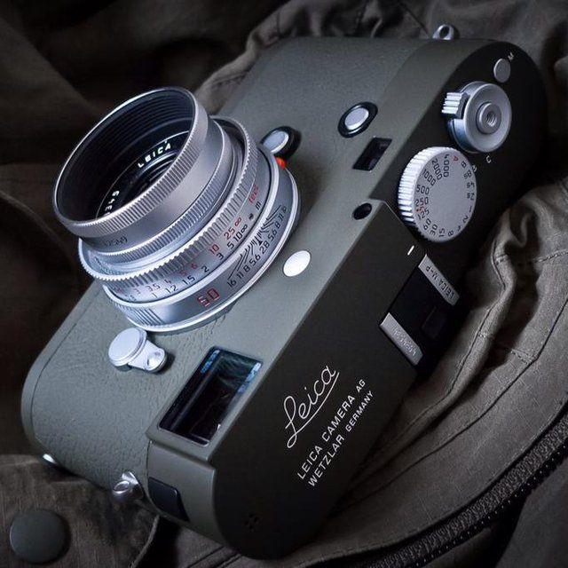 "Fancy - Leica M-P Typ 240 Safari Camera $9 900USD Leica Camera presents the Leica M-P Set ""SAFARI"". This set comprises of the Leica M-P (Typ 240) Safari edition, Leica Summicron-M 35mm/f2 ASPH with round metal lens hood, a full grain cowhide carrying strap and matching SD & business card holder. Leica's safari/olive edition cameras date back to 1960 with the Leica M1 ""Olive"". Made initially for the military, the safari/olive cameras' unique color stands out. Over the years, a handful of…"