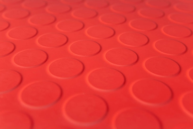 Idea if kitchen floor needs replacing.  Lots of colours available.   Round stud bright red rubber flooring | The Rubber Flooring Company