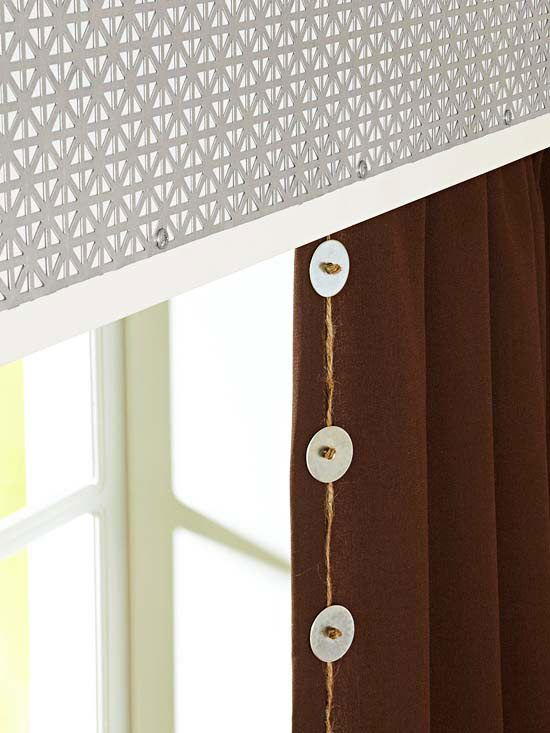 Industrial embellishments. Valances add height and depth to plain windows. Here, Grecian-pattern grilles are screwed directly to the faces of painted medium-density fiberboard (MDF) valances. Metal washers and twine attached to the drapery edges tie in with the industrial look of the valances above./