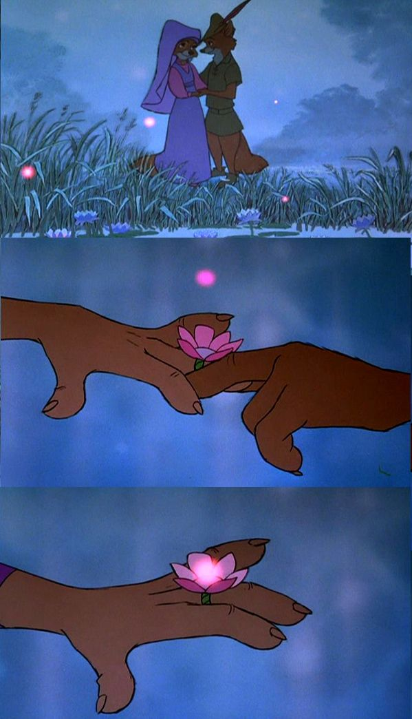 Robin Hood gives Marian a flower ring. Such a pretty scene!