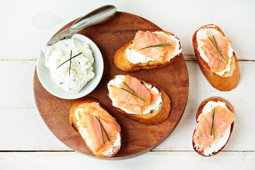 Smoked Salmon and Goat Cheese Bruschetta Recipe Appetizers with cream cheese, soften, goat cheese, garlic, chives, salt, baguette, softened butter