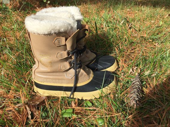 Womens size 7 Sorel duck boots great vintage condition with wear marks on the leather that give them a nice broken in look. Very comfortable and