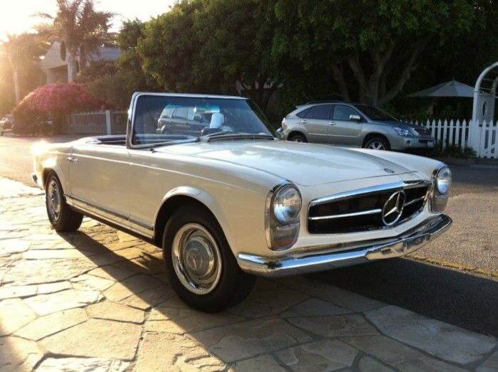 1965 on the outside. 2012 on the inside. Gorgeous Mercedes-Benz 230 SL that's been converted into an electric car.