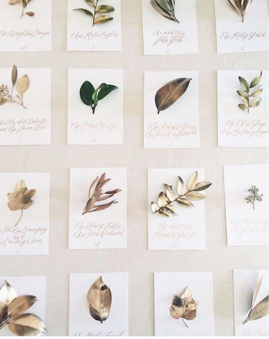 Branch + leaf gilded escort cards via The Written Word Calligraphy