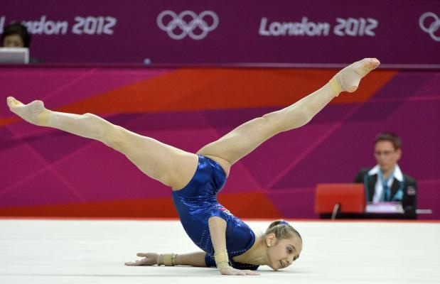 Russian gymnast victoria komova goes through her routine for Floor gymnastics