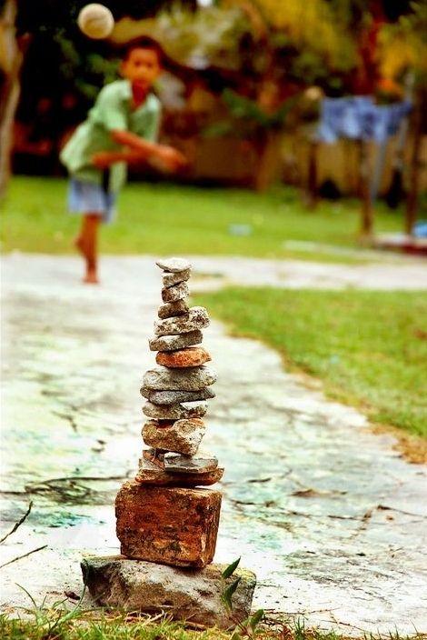 """throw a rock pile """"galah batu"""""""