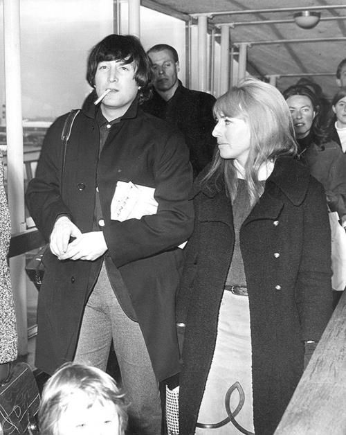 February 8, 1965 - John and Cynthia, followed by George Martin and his then fiancee Judy Lockhart-Smith, just arrived back at Heathrow Airport from their ski holiday together in St. Moritz, Switzerland. Brian Epstein met them at the airport and reported to the press how well John had done learning to ski. Three days later the Lennon's attended the super secret wedding of Ringo Starr and Maureen Cox in London!