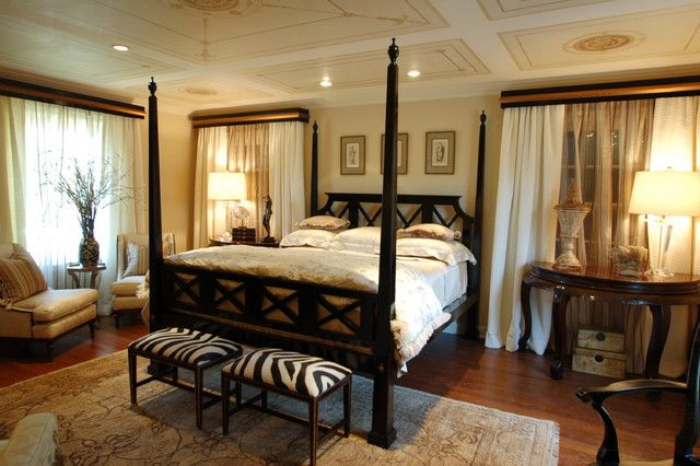 Bedroom with Twin Stools as ottomans on Rug Coupled Canopy Bed