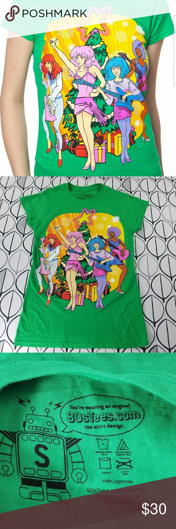 "Jem And the Holograms Christmas t shirt Retro 80s Retro looking Christmas t-shirt made by 80s tees. In perfect condition bright kelly green shlet sleeved shirt with graffic of Jem and the Holograms rocking out at a christmas party! Don't miss this chance they are sold out online and no longer availible. Vibrant colors with pink purple red blue yellow all the colors. Size small measurements laying flat are approximate bust 15""-17"" stretched length 24"" christmas epic 1980s Jem cartoons geek…"