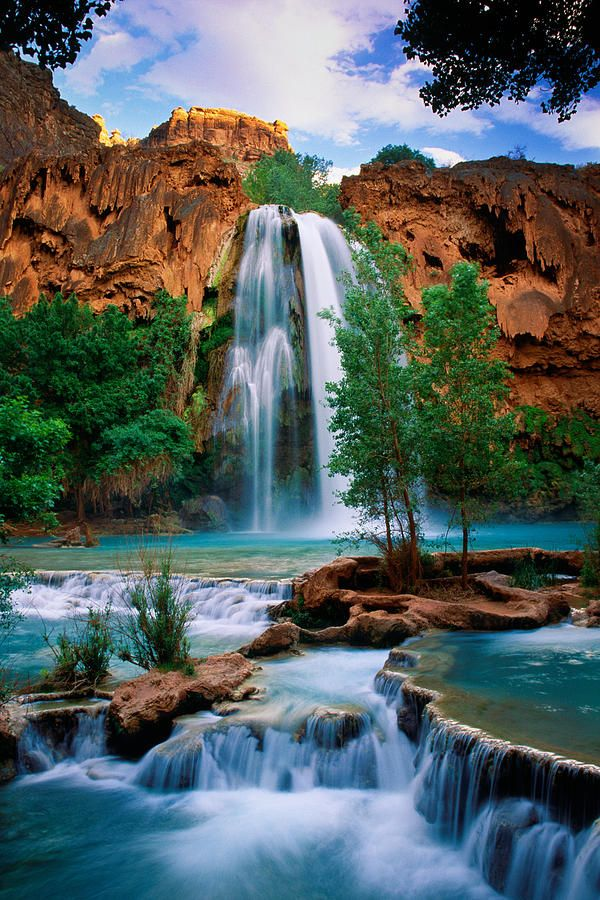 ✮ Havasu Falls, Havasupi, Az. Been there, swam that. it's gorgeous! Hike 8 miles to a Havasupi indian village which is the only place in the US that still gets its mail by donkey, another 2 miles to these falls. There are no roads into the village. You either hike in, or fly in by helicopter (I flew OUT by helicopter after near heat stroke on the way out ;)