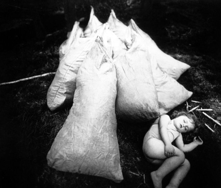"""Sally Mann- Immediate Family, 1992  Artist's statement:  """"These are photographs of my children … many of these pictures are intimate, some are fictions and some are fantastic, but most are of ordinary things every mother has seen. I take pictures when they are bloodied or sick or naked or angry. They dress up, they pout and posture, they paint their bodies, they dive like otters in the dark river.""""  Read more about Sally Mann at Gagosian Gallery."""