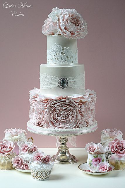 Pretty lace and floral wedding cake